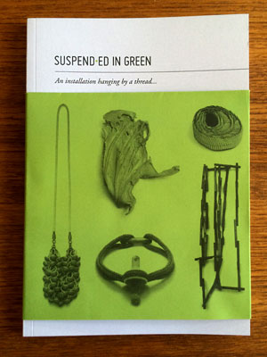Suspended in green